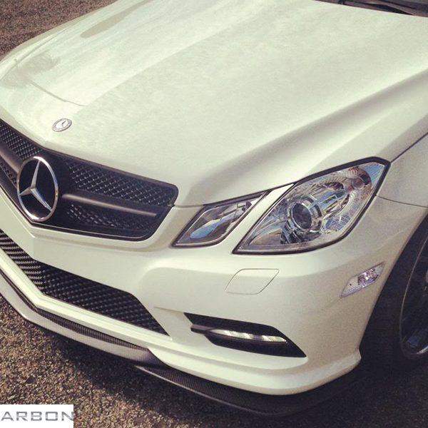 Godhand Style carbon fiber front lip installed on mercedes e550 sport